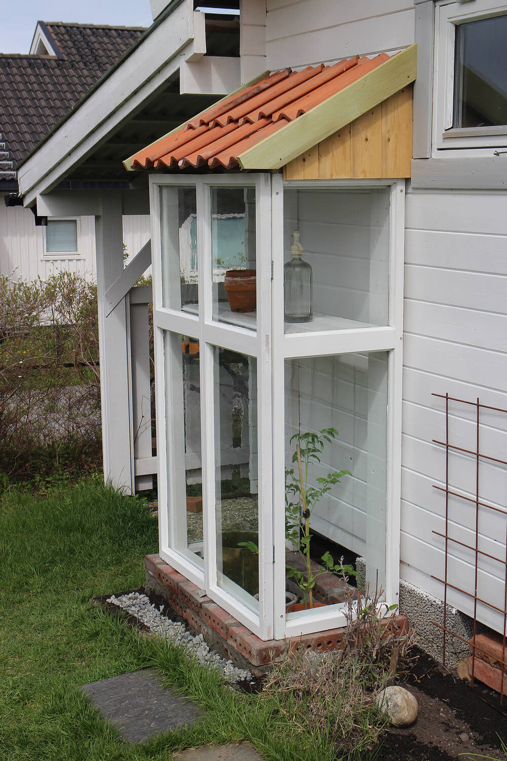 Long and Lean Glass Greenhouse Home Addition
