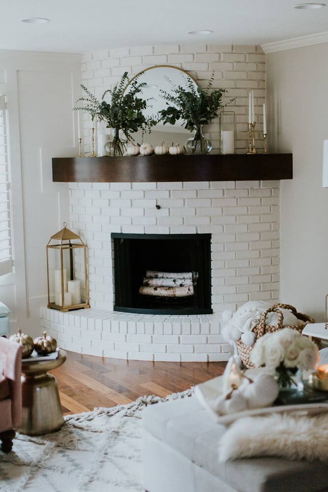 A Curved Fireplace Decorate in Brass and Nature