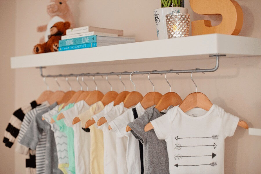 Dainty and Industrial Rod Baby Clothes Display