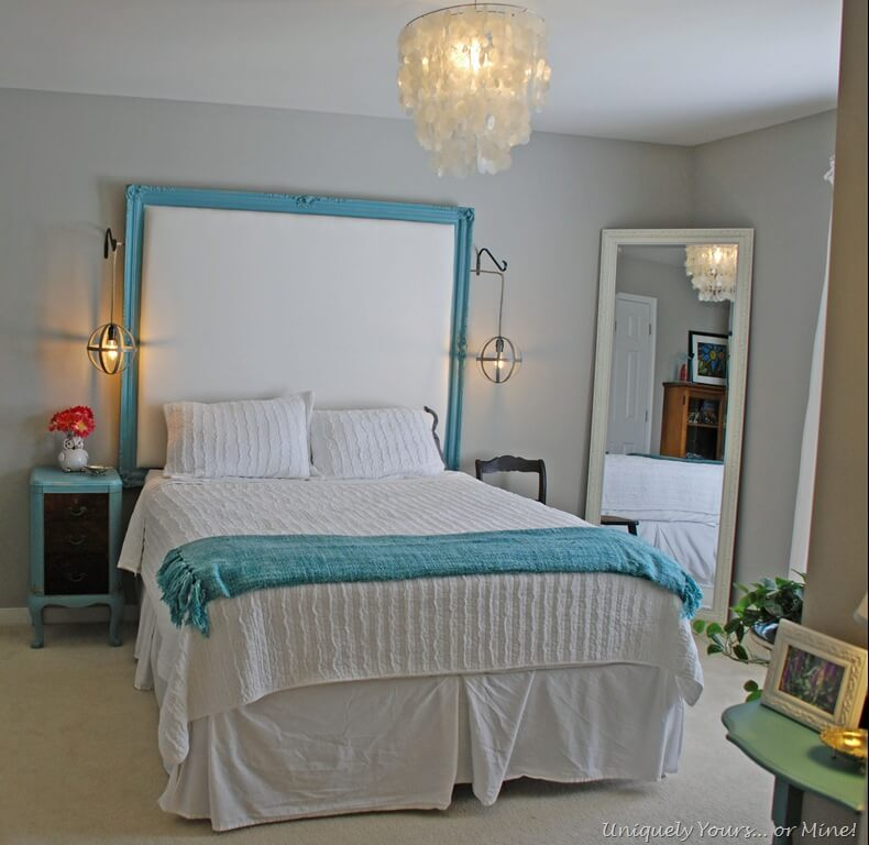 Oversized Headboard with Turquoise Accents and Chandelier